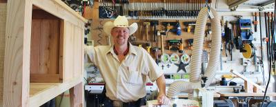 Owner Paul Adams runs his woodworking business from his garage in Magnolia.