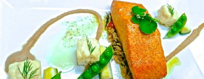 Smoked salmon ($27) is served with sunchoke puree, orzo with spinach pesto, citrus butter and glazed vegetables.