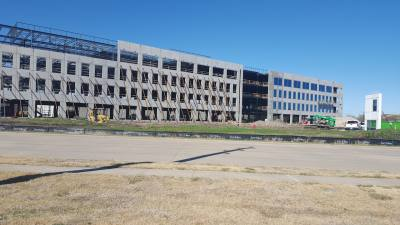 Telecommunications equipment supplier Alcatel-Lucent is constructing a four-story office building off Independence Parkway just south of Plano Parkway.