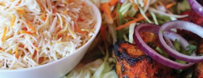 Tandoori chicken ($10.49) is barbecued and served with steamed rice.