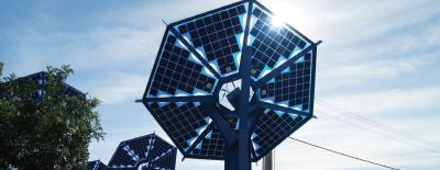 Solar panels, such as those on I-35 near the Mueller neighborhood, can lower utility bills in the long term, but the setup cost is more than many can afford.