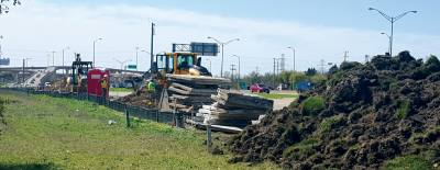 Workers ready a construction area on Dallas Parkway at the President George Bush Turnpike.