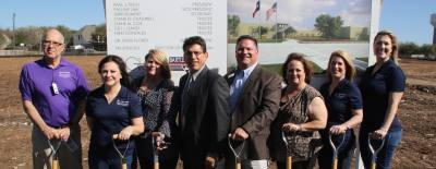 From left to right: Round Rock ISD trustees Charles Chadwell, Nikki Gonzales and Diane Cox, Superindentendant Steve Flores, Board President Paul Tisch, and trustees Terri Romere, Suzi David and Pauline Law break ground on Middle School No. 11.