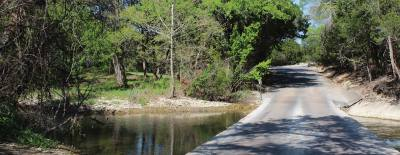 A low-water crossing over Brushy Creek on CR 177 in Leander runs directly between city-governed property to the north and county property to the south, which is among land Leander City Council has proposed to annex in April.