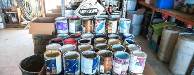 Dozens of paint cans sit at Williamson County Recycle Center nawaiting disposal.