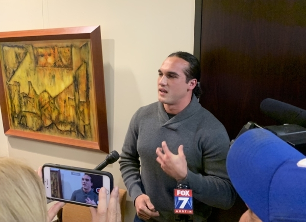 Greg Kelley, a former Leander High School student whose 2014 conviction was recently overturned, told members of the press after the Cedar Park City Council meeting Nov. 14 that he wants the Cedar Park police chief and sergeant who worked on his case to be held accountable for what happened to him. (Marisa Charpentier/Community Impact Newspaper.