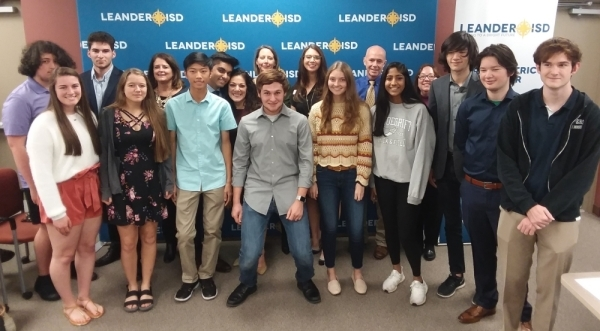 Leander ISD trustees are pictured with some of LISD's 27 National Merit Semifinalists at the Nov. 21 board meeting. (Brian Perdue/Community Impact Newspaper)