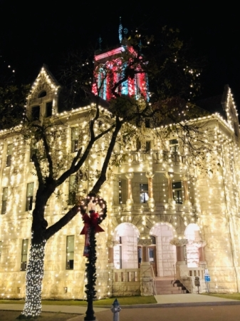 The Comal County courthouse is lit up in downtown New Braunfels for the holiday season. (Ian Pribanic/Community Impact Newspaper)