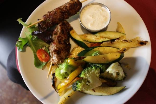 Moroccan kefta kebabs ($8.95) feature ground steak with minced peppers and spices, served with two sides. (Kara