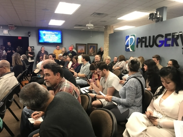"""Pflugerville City Hall was standing room only at Pflugerville City Council's Jan. 14 meeting for the first ordinance reading on """"Project Charm,"""" a 3.8 million-square-foot distribution center. (Kelsey Thompson/Community Impact Newspaper)"""