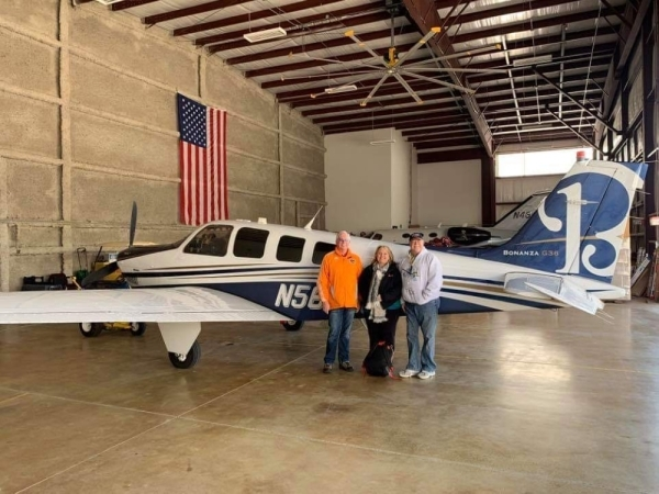 HGA driver Derek King picks up a patient from David Wayne Hooks Memorial Airport in Spring before transporting her to the Texas Medical Center. (Courtesy Derek King)