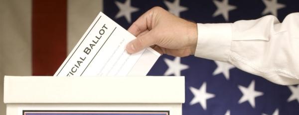 hand placing ballot in ballot box fotolia stock image vote