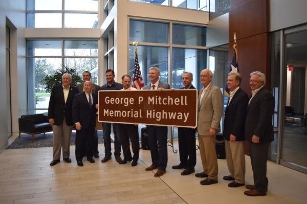 J.J. Hollie, The Woodlands Area Chamber of Commerce president (center) is flanked by Montgomery County officials, representatives and community members at the dedication of a portion of I-45 on Jan. 17. (Vanessa Holt/Community Impact Newspaper)