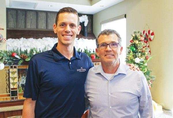 James Hanigan (right) opened the first location of Hanigan & Johnson in 2000. (Kara McIntyre/Community Impact Newspaper)
