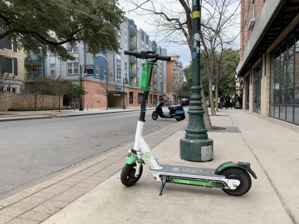 New dockless vehicles, such as Revel mopeds, have entered the Austin market, in addition to electric scooters, pictured here in West Campus. (Emma Freer/Community Impact Newspaper)
