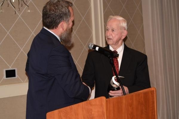 Mayor Tom Reid accepting award at a podium