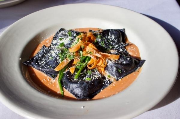 Black linguine stuffed ravioli is served with a house-made pink sauce. (Taylor Jackson Buchanan/Community Impact Newspaper)