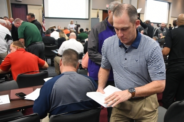 CFISD Director of Athletics Ray Zepeda distributes UIL realignment documents to district coaches on Feb 3. (Courtesy Cy-Fair ISD)