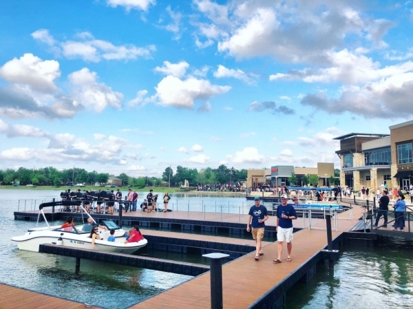 Residents gather at the Boardwalk at Towne Lake, a mixed-use development in Cypress. (Courtesy Caldwell Companies)