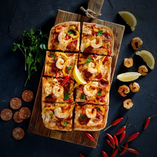 With a handful of locations in The Woodlands and Spring areas, the pizza chain Chicago-style thin crust pizzas that are made from scratch. (Courtesy Crust Pizza)