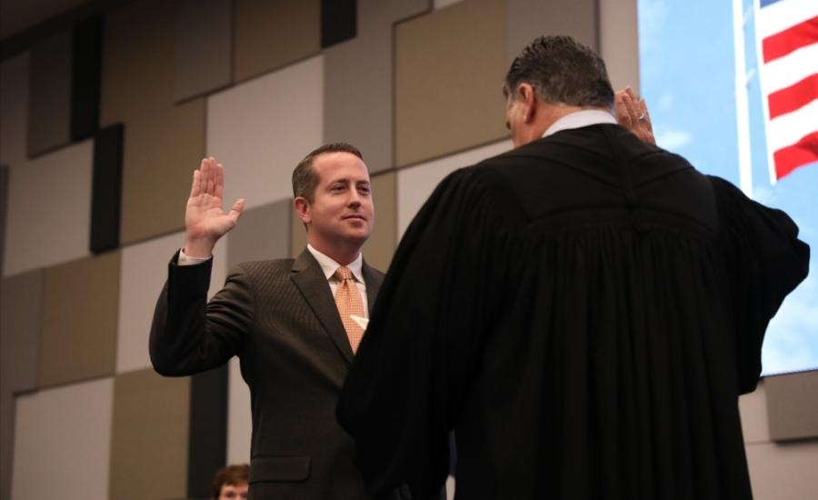 Philip Hassler was sworn onto the McKinney ISD's Board of Trustees during a Feb. 25 meeting. (Liesbeth Powers/Community Impact Newspaper)