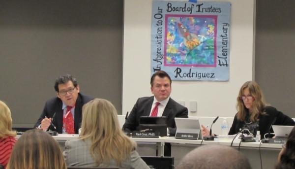 Austin ISD board President Geronimo Rodriguez (left) sits next to Superintendent Paul Cruz at a Feb. 24 board meeting. (Nicholas Cicale/Community Impact Newspaper)