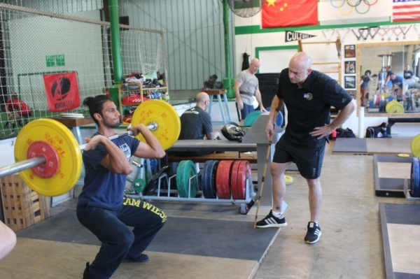 Olympic weightlifter Robert Ronan (right) founded Austin Barbell in 2018. (Nicholas Cicale/Community Impact Newspaper)