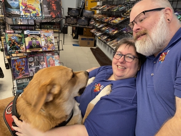 Melyssa Childs-Wiley and Shannon Wiley are kept company at the shop by their dog, Pancake. (Renee Yan/Community Impact Newspaper)