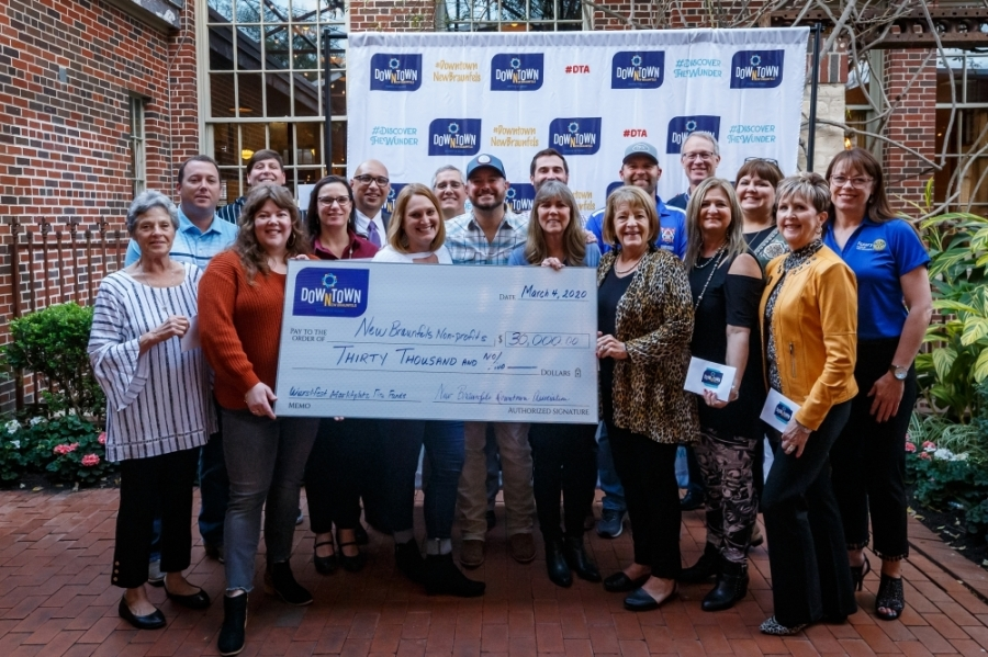 Nonprofit vendors accepted a $30,000 check to assist is replacing their Wurstfest equipment. (Courtesy Mikie Farias/New Braunfels Downtown Association)
