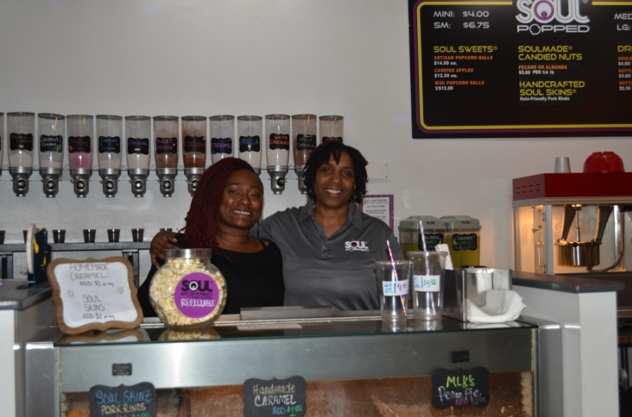 Owner De J. Lozada (right) stands with Assistant Manager Tiffany Nance. (Amy Rae Dadamo/Community Impact Newspaper)