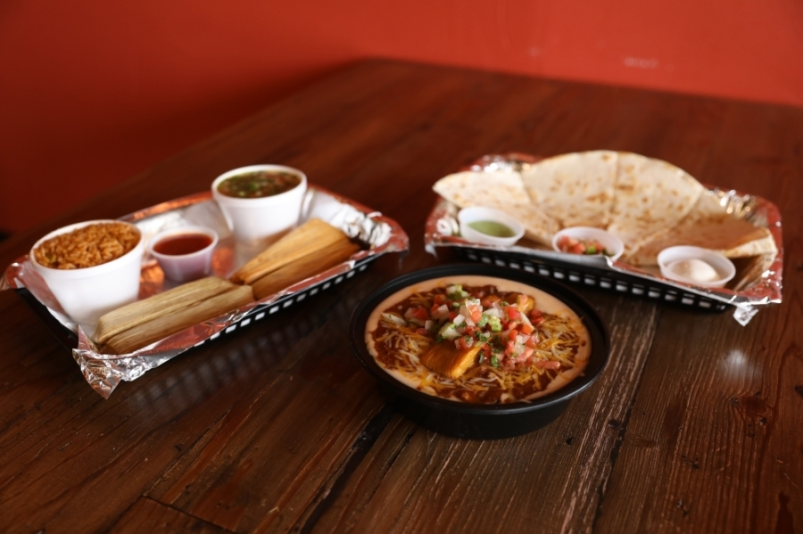 Tommy Tamale dining options include the Tamale Plate ($6 for two, $8 for four), served with rice and beans; the Tommy Bowl ($7 one tamale, $9 two tamales), a beef chili, queso, pico and rice bowl with a choice of tamale; and quesadillas ($8 for one 12-inch, $12 for two),  which can include steak, tamale pork, chicken or beans and are served with sour cream, salsa and pico de gallo. (Photos by Liesbeth Powers/Community Impact Newspaper)