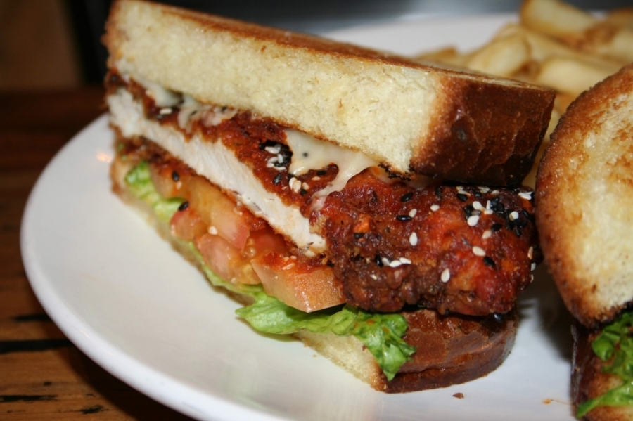 One of owner Benny Polisi's personal favorites is the buffalo chicken burger ($8.99), which he makes with Swiss cheese, lettuce, tomatoes and brioche bread. (Renee Yan/Community Impact Newspaper)