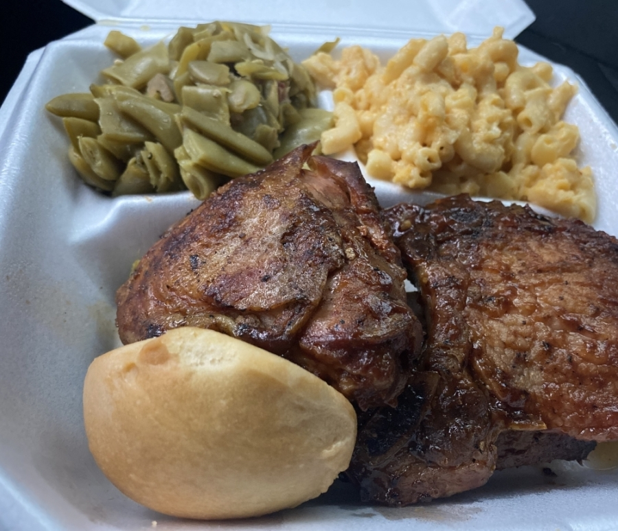The restaurant offers a barbecue sampler, which includes two ribs, chicken and a porkchop, three sides, a roll and iced tea. (Makenzie Plusnick/Community Impact)