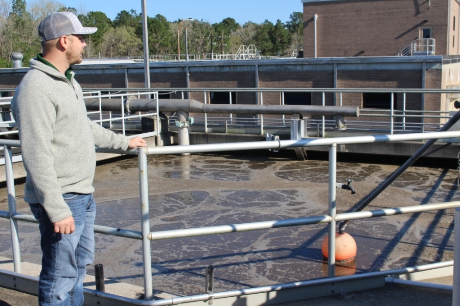 Greg Hall, superintendent of Conroe's wastewater treatment plant, says the new plant will ease some of the burden from the existing plant, which is pictured. (Eva Vigh/Community Impact Newspaper)