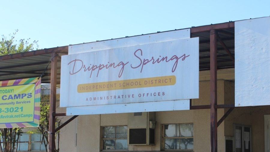 """A photo of a sign that reads """"Dripping Springs Independent School District Administrative Offices"""""""
