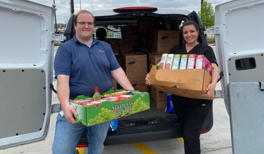 COVID-19 North Texas Relief group members Joel Upton and Adrianne Hudson load food collected March 18 for a senior living facility in Denton County. (Courtesy Adrianne Hudson)