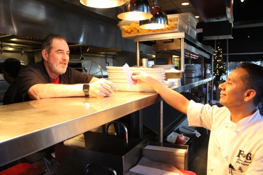 Chefs Bob Stephenson (left) and Carlos Arevalo (right) opened FnG Eats together in Keller in 2012. Together, they have created a new take-and-bake menu to serve customers during the coronavirus outbreak. (Renee Yan/Community Impact Newspaper)
