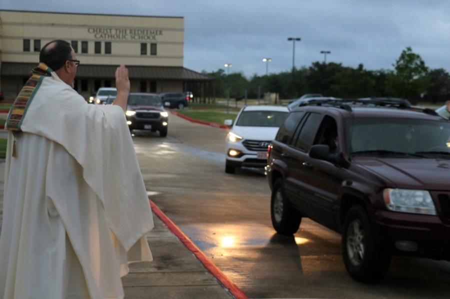 """More than 100 cars fill the parking lot as Christ the Redeemer Catholic Church holds its first """"drive-in benediction"""" event for its congregants. (Courtesy Christ the Redeemer Catholic Church)"""