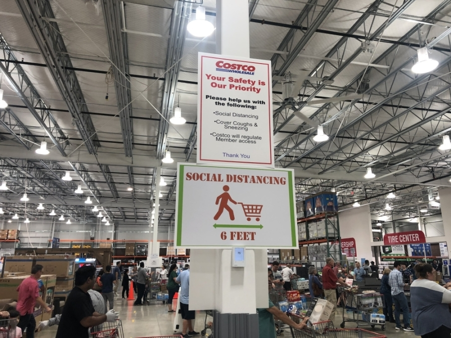 Signage at the Pflugerville Costco illustrates social distancing practices, which the Centers for Disease Control and Prevention recommend to help reduce the spread of COVID-19. (Community Impact Staff)