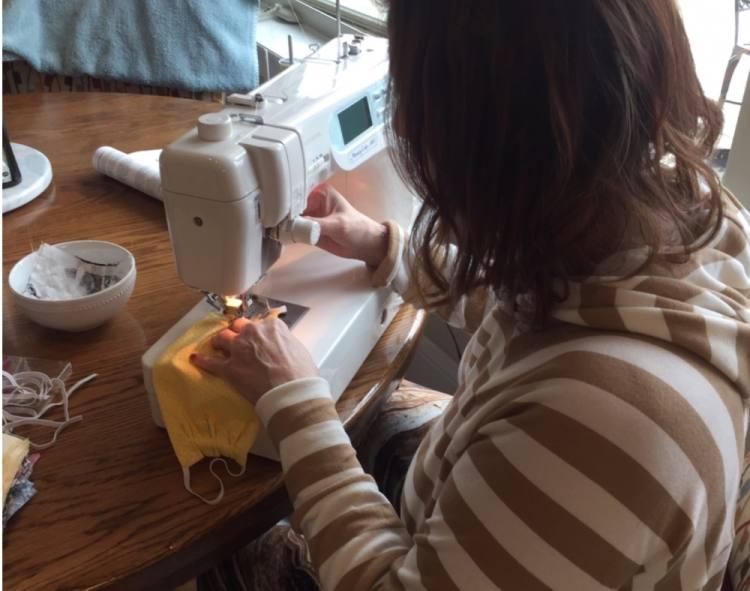 Nancy Garner works on face masks at her sewing machine. (Courtesy Nancy Garner)