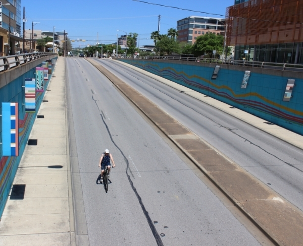 A bicyclist rides down Lamar Boulevard on March 25. (Christopher Neely/Community Impact Newspaper)