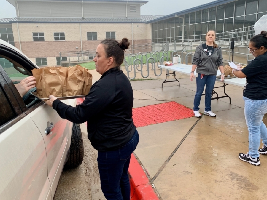 Lake Travis ISD's Food and Nutrition Services is continuing to provide free meals through a grab-and-go drive-thru at the district's middle schools. (Courtesy Marco Alvarado)
