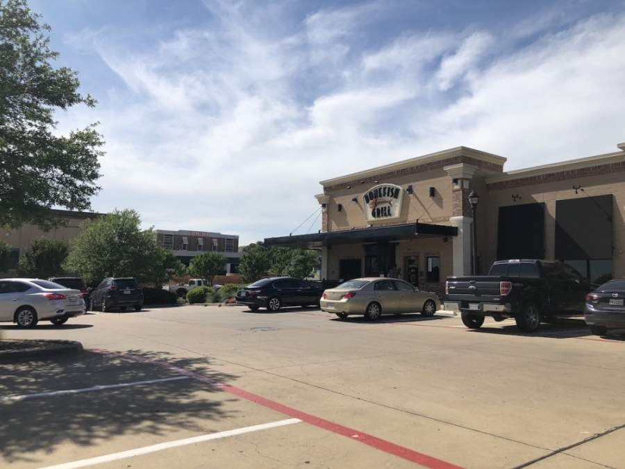 Southlake patrons walk by Bonefish Grill in the city's town square. (Ana Erwin/Community Impact Newspaper)