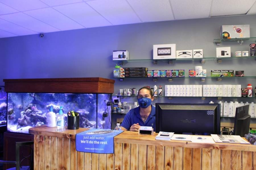 On May 1, the first day of loosened retail and restaurant restrictions imposed due to the COVID-19 pandemic, owner John Duncan sports a protective facemask inside of Coral Fish and Beyond, located at 2041 Rufe Snow Drive, Ste. 303, Keller. (Ian Pribanic/Community Impact Newspaper)