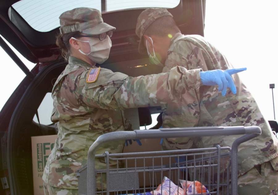 """""""[The National Guardsmen] have been such a blessing to us and they've helped take over the operation and the distribution,"""" said New Braunfels Food Bank Executive Director Monica Borrego. (Lauren Canterberry/Community Impact Newspaper)"""