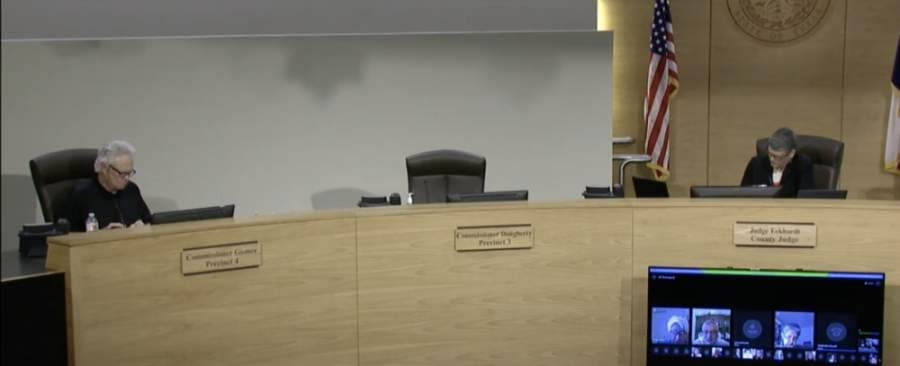 A screen shot of a Travis County Commissioners Court meeting