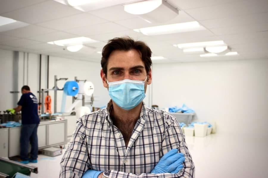 Lloyd Armbrust, founder and CEO of Armbrust American, developed an automated system to produce surgical face masks at a Pflugerville facility. (Taylor Jackson Buchanan/Community Impact Newspaper)