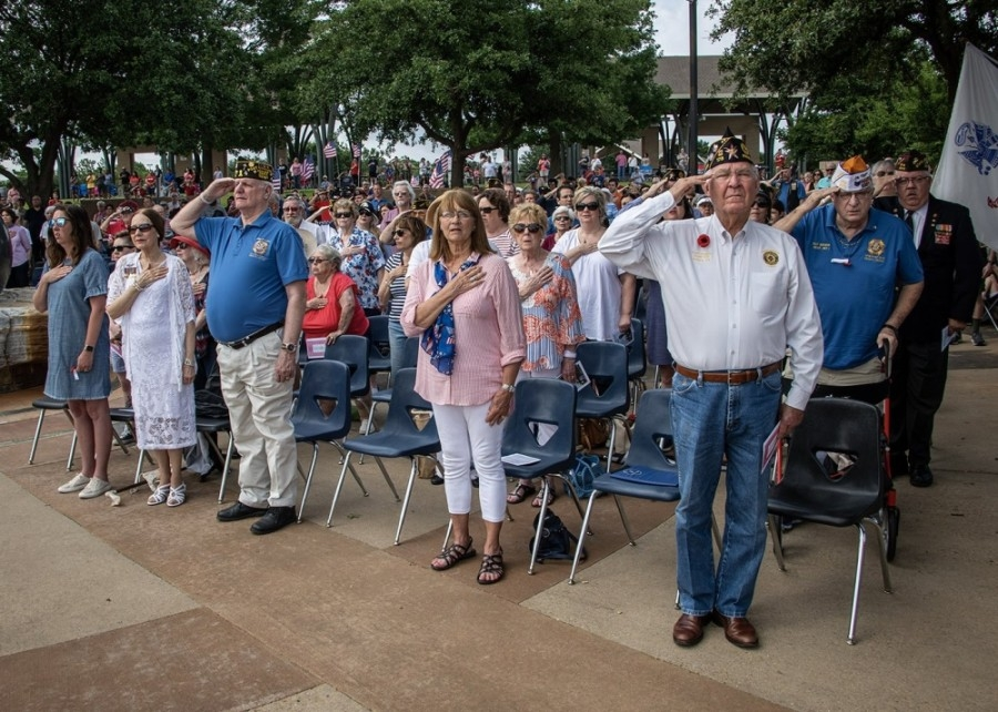 Attendees stand at attention during last year's Memorial Day ceremony at the Veterans Memorial within Frisco Commons Park. This year's event is scheduled for 9 a.m. May 25 at the same location. (Courtesy Frisco VFW Post 8273)