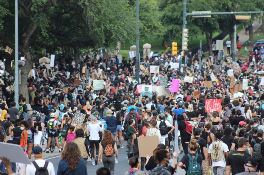 Protesters march toward the Texas Capitol. (Christopher Neely/Community Impact Newspaper)