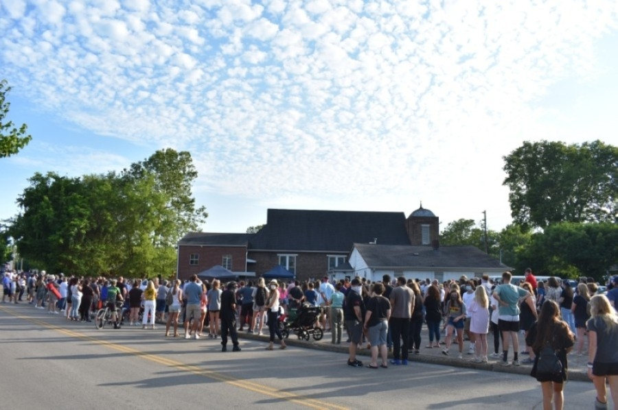 Hundreds of Franklin residents overflowed from the corner of the First Missionary Baptist Church parking lot to listen to church leaders, educators, city officials and concerned citizens speak out against systemic racism across the country at a candlelight vigil held June 2. (Alex Hosey/Community Impact Newspaper)